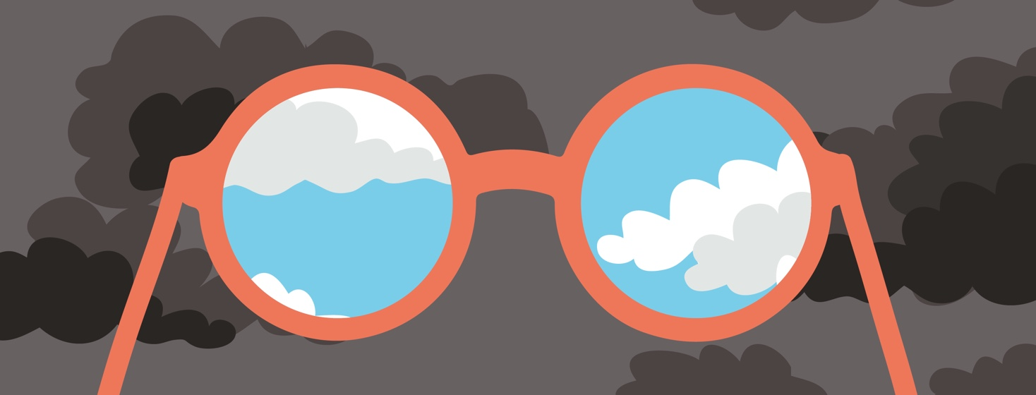 A pair of glasses seeing sunny skies while the rest of the sky shows dark clouds, representing perspective.