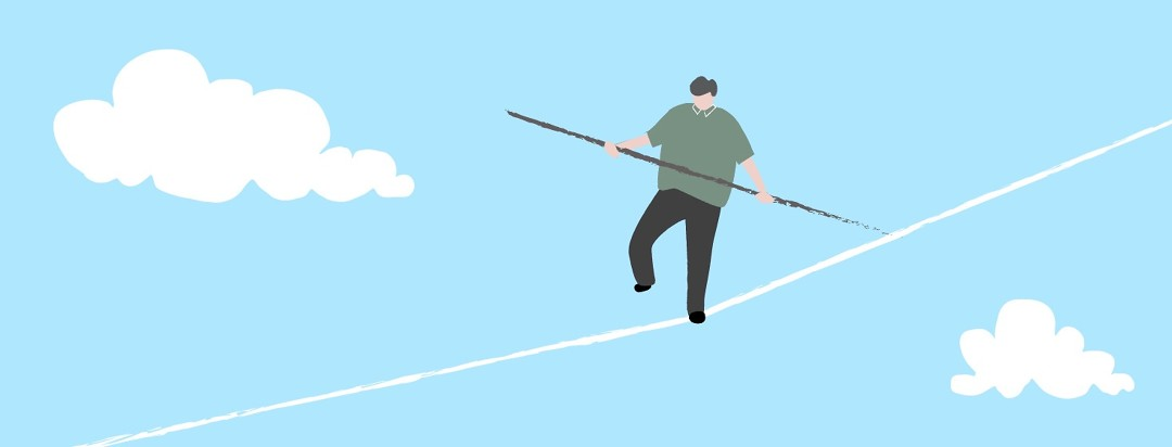 An image of a man walking on a tightrope