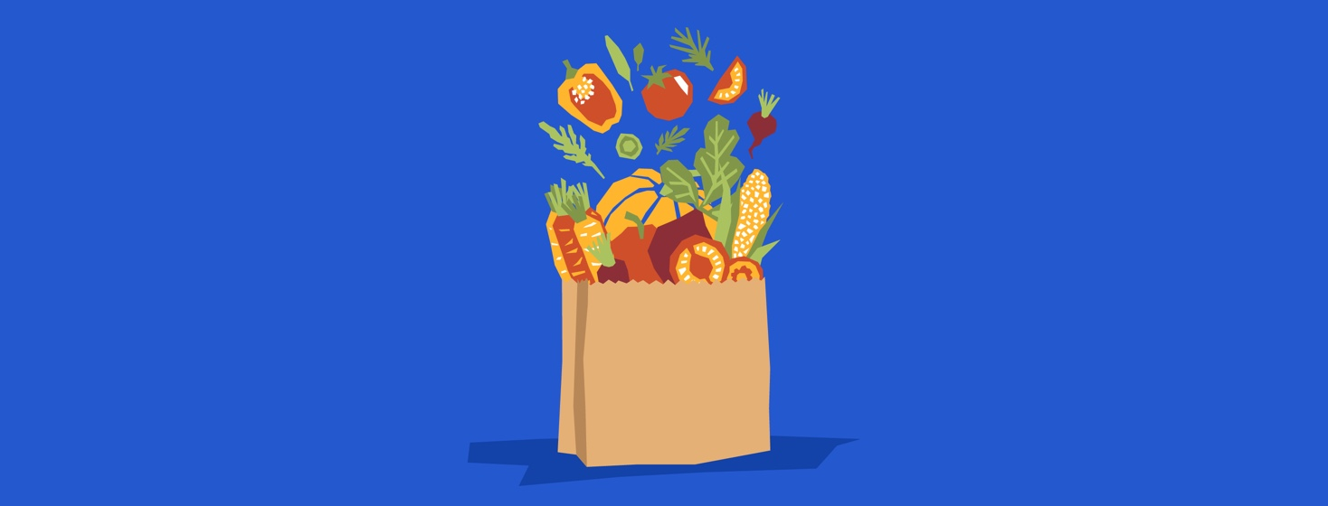 Grocery bag with healthy fruits and vegetables coming out