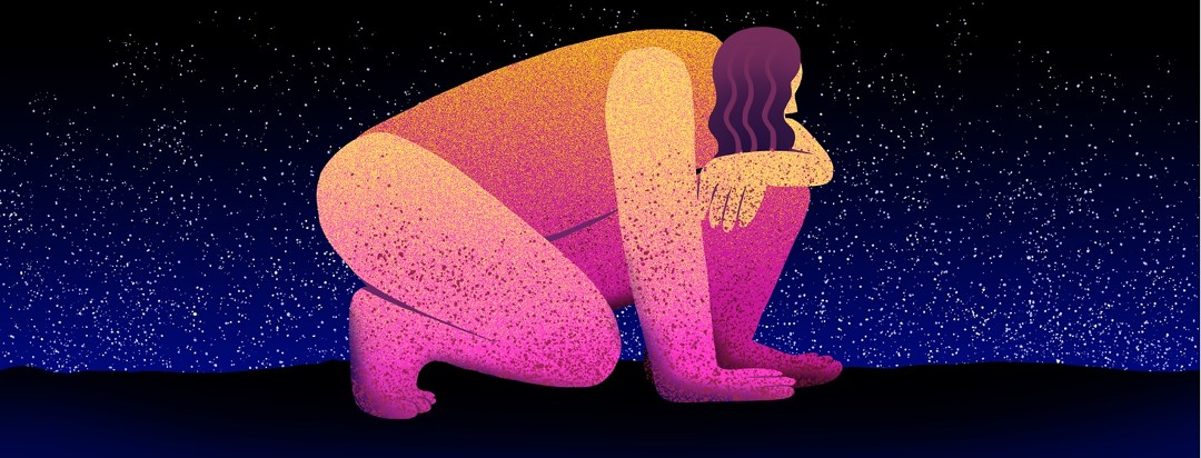 A person with red spots on their hands, feet, arms and legs crouches on the ground against a night sky.