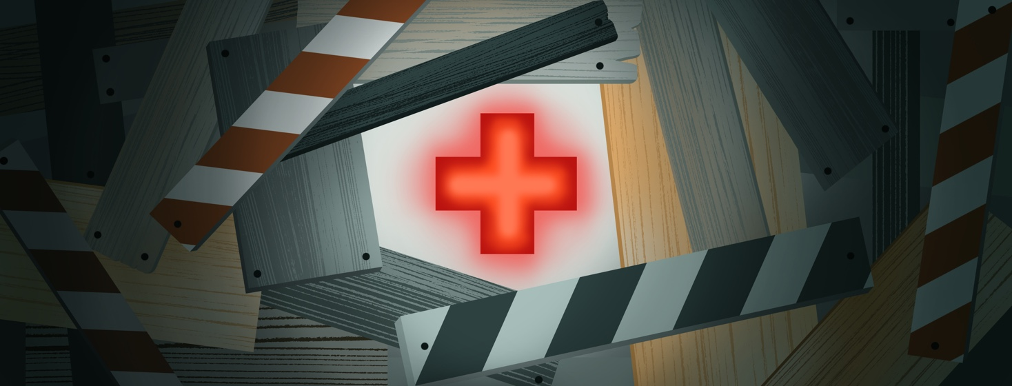 A red cross emits a soft neon glow in a space surrounded by wooden barriers nailed to the wall space around it.