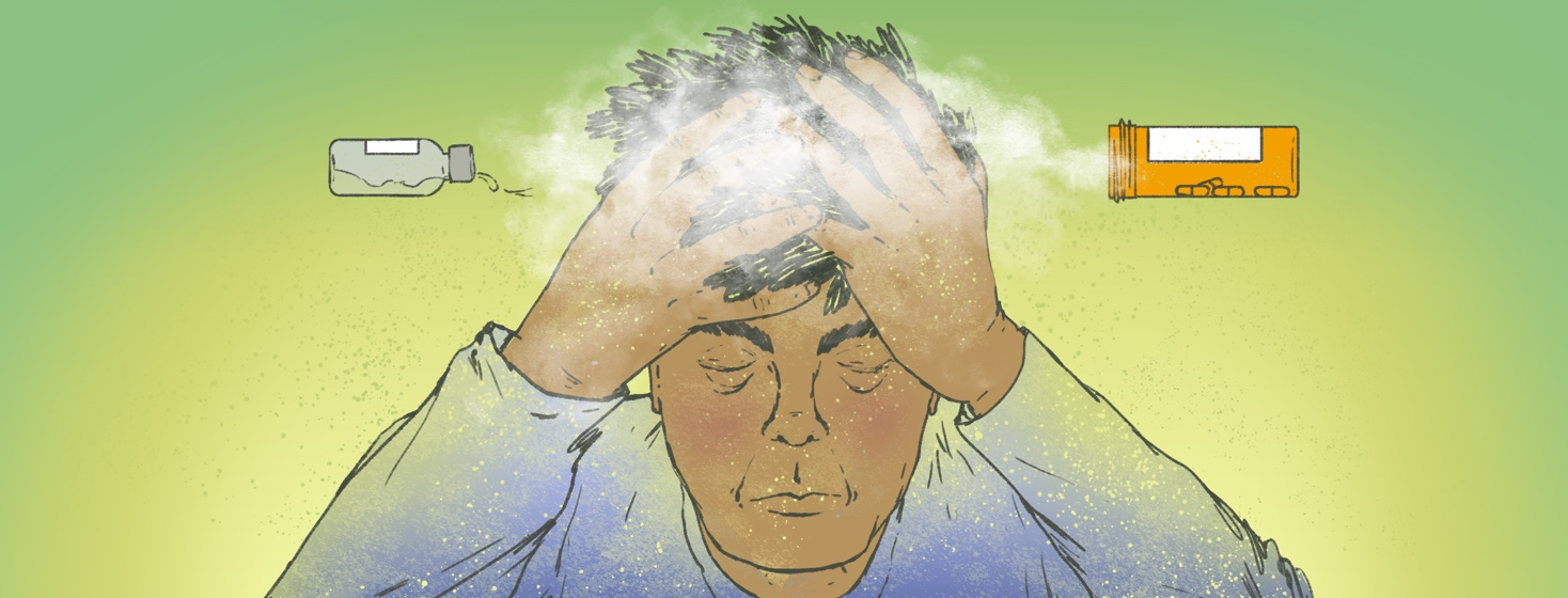 A man holds his head in his hands. Two bottles of medication are overturned and spilling out what looks like a cloud of fog over the man's head.
