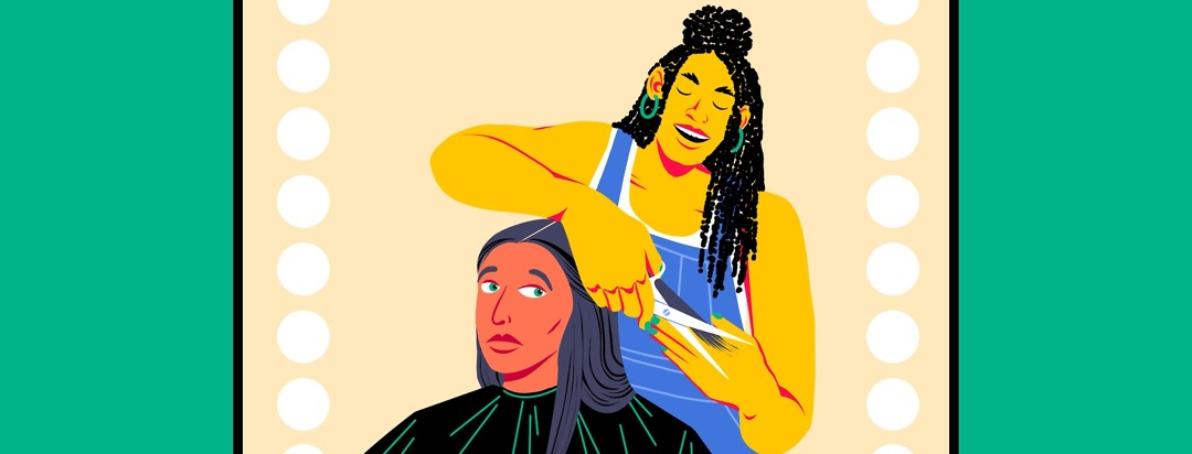A hairdresser is cutting a woman's hair. The woman is looking nervously at the hairdresser's scissors.