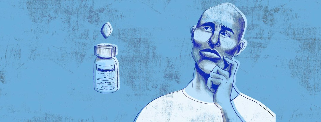 a man stares up at a bottle of pills with a very contemplative look on his face