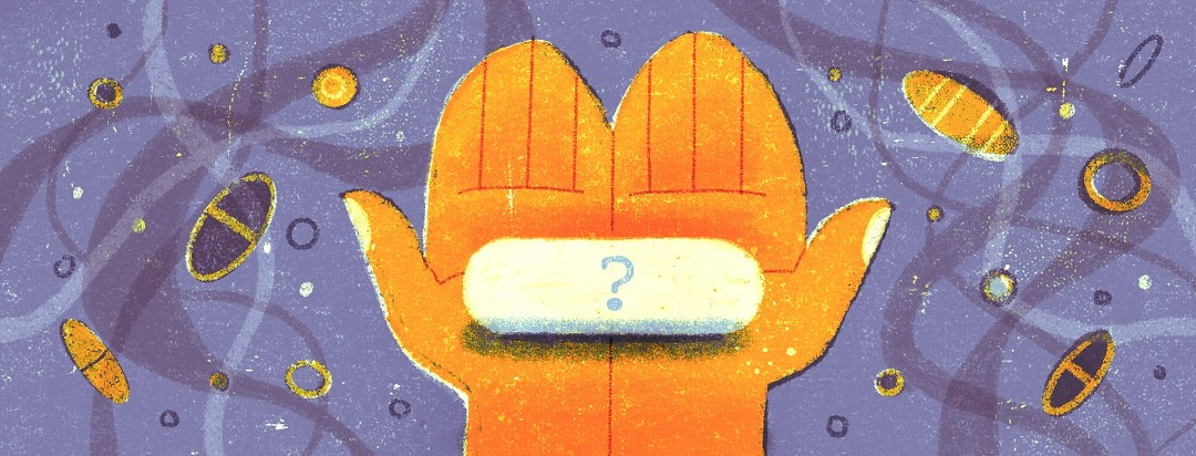 a hand holding a pill with a question mark on it