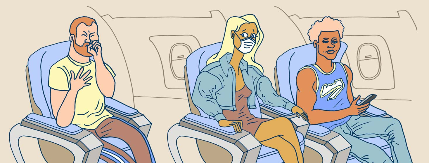 a row of airplane seats has one female passenger with a mask on and a worried look as the person behind her coughs