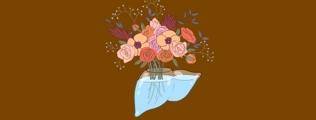 a glass liver is actually a vase filled with water and a beautiful bouquet of flowers