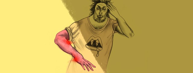 a man in a vampire t-shirt is shocked to see his arm covered in porphyria cutanea tarda