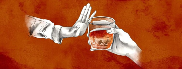 a hand pushes away a cocktail