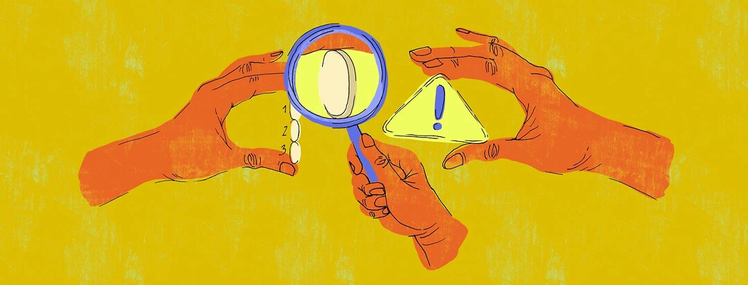a hand with a magnifying glass is inspecting another hand holding mavyret pills